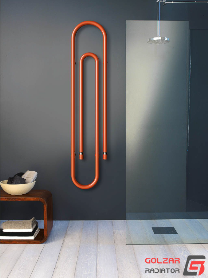حوله خشک کن دکوراتیو نارنجی رنگ که به شکل گیره کاغذ طراحی شده است